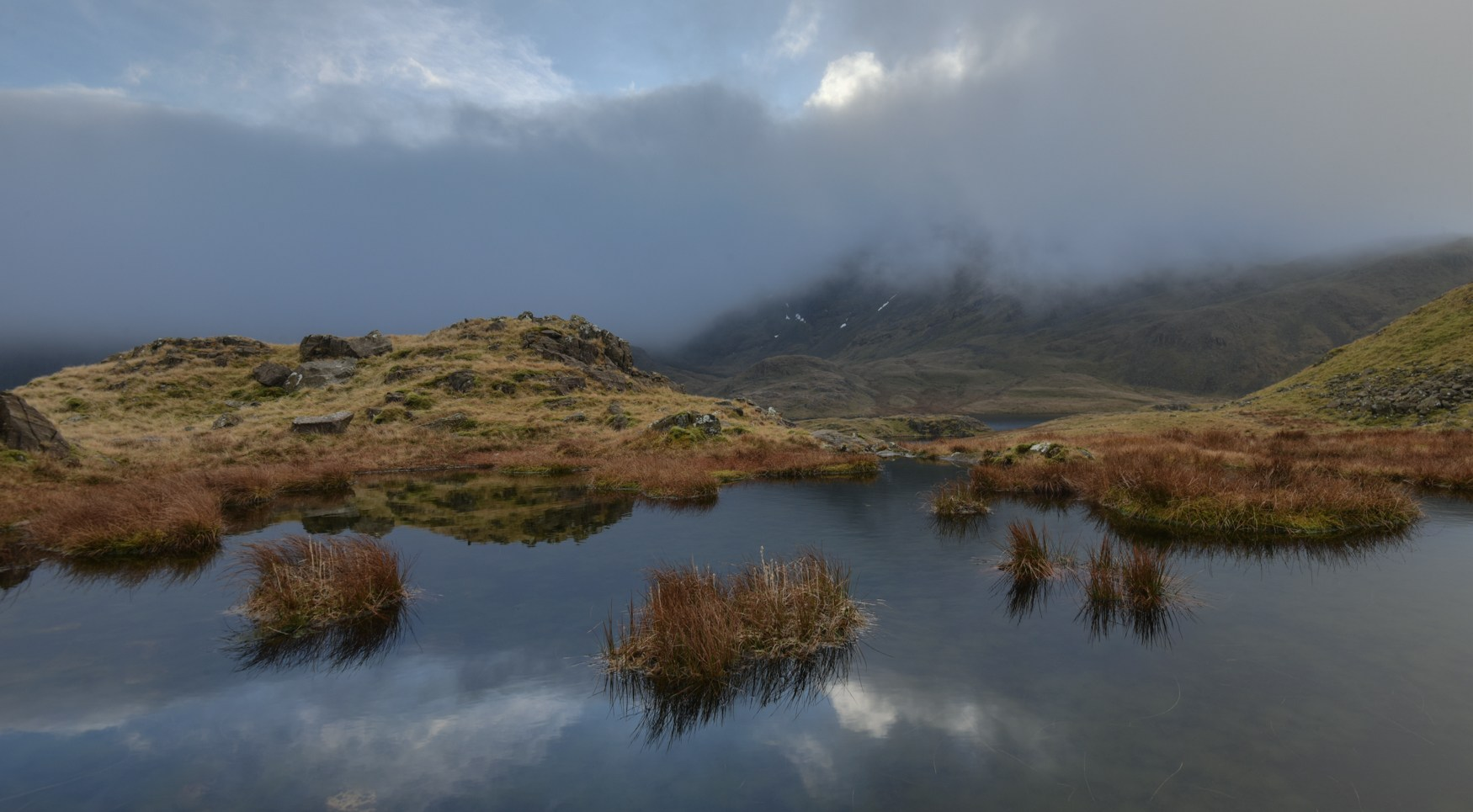 Light on a small, nameless Tarn above Sty Head Pass.