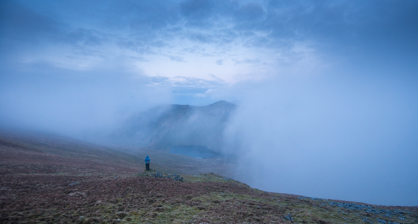 Making notes from below Harter Fell as the cloud swirls to reveal Kentmere Reservoir