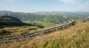 Looking down onto the Langdale Valley over the high fell wall on Lingmoor.
