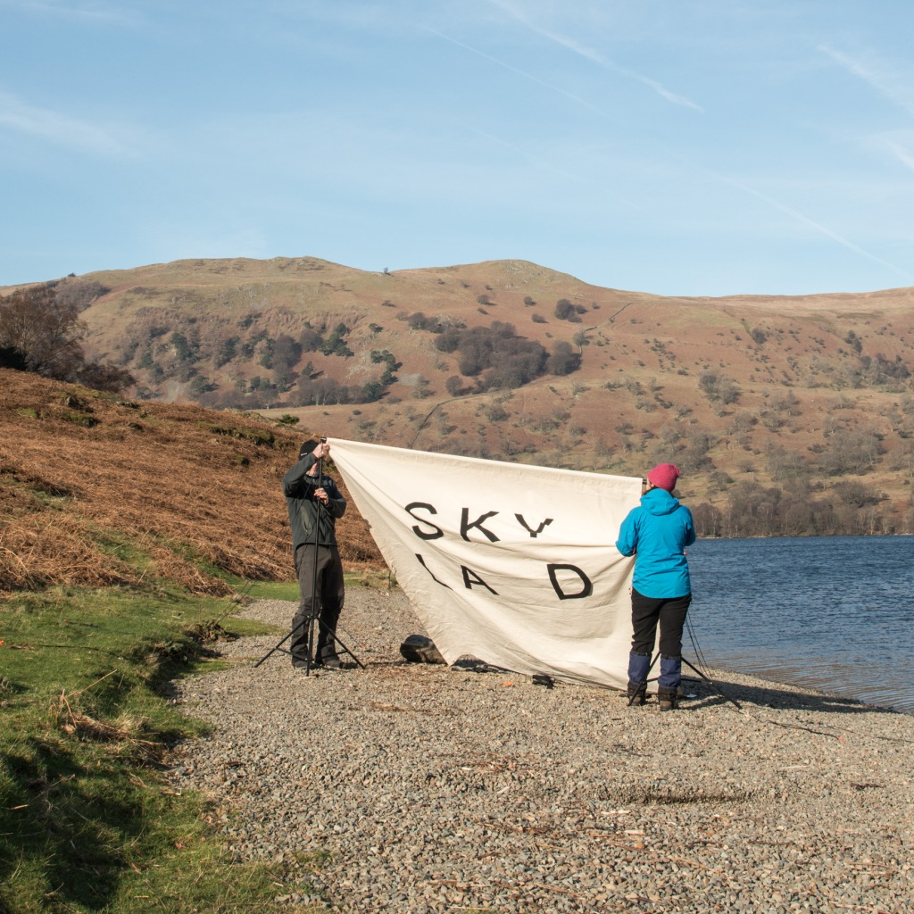Our first attempt to put up the canvas failed in the strong winds. We had to replace some of the letters and think whether to go ahead or not. A tough choice that we talked through while the wind continued to gust.