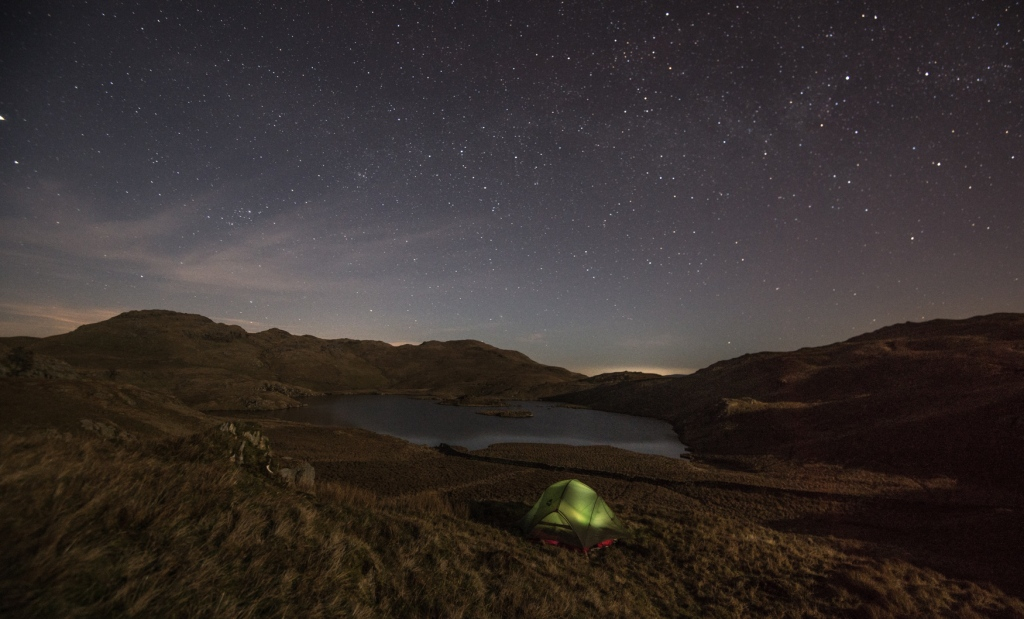 The tent bathed in moonlight and beneath the stars