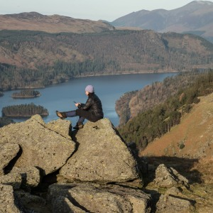 Harriet making notes by the old hut with Thirlmere beyond her