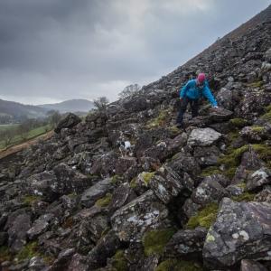 Heading across the screes below Helm Crag.