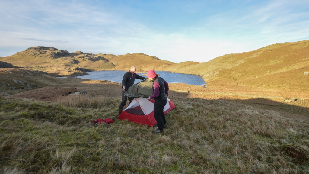 Putting up the tent on the 60 degree line near Angle Tarn