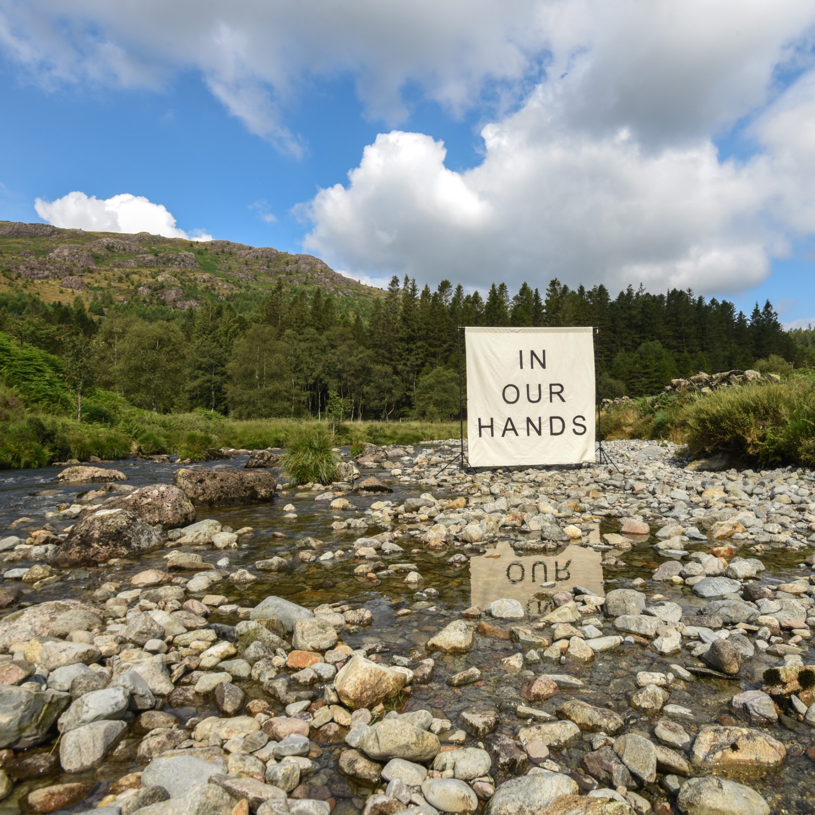 August 'Sense of Here' Canvas: In Our Hands, placed in the River Duddon