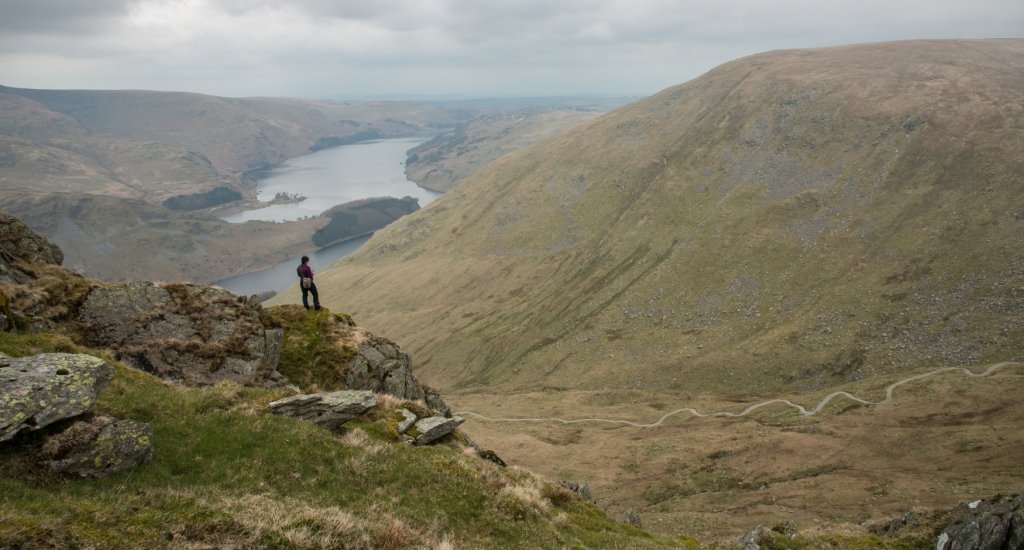 Harriet making notes from a crag with Artlecrag summit and Haweswater beyond