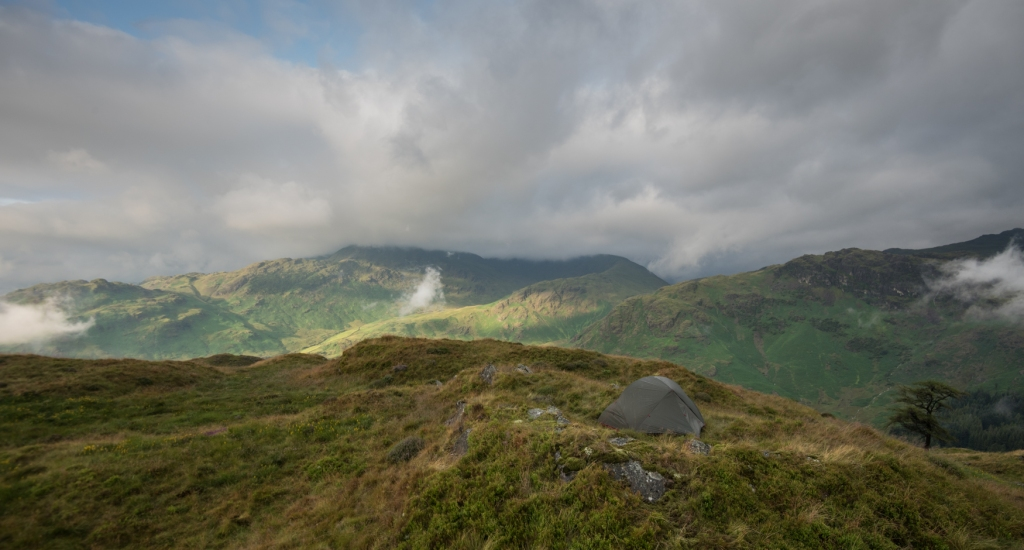 The morning after the storm, with the clouds still rolling over the fells.