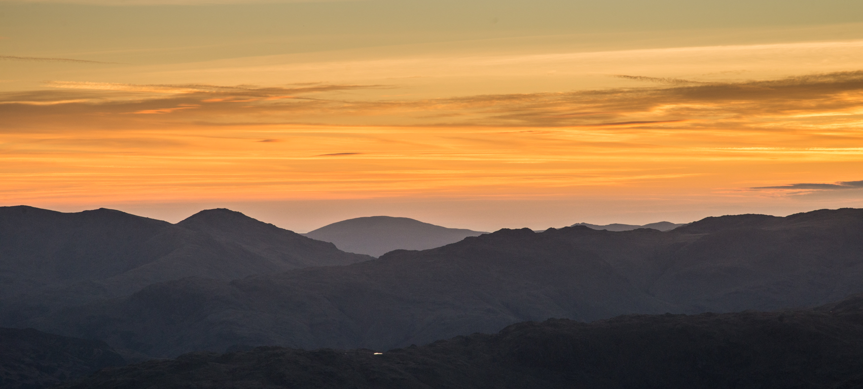 Looking westwards to the setting sun from the Helvellyn ridge